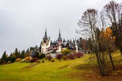 Peles castle, Sinaia, Romania.Overcast on a beautiful autumn day. Wider view royalty free stock image