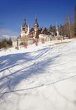 Peles castle, Sinaia Romania. winter scene Royalty Free Stock Image