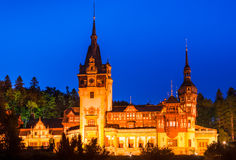 Peles Castle in Sinaia, twilight view, Romania. Night view with Peles Castle, built by King Carol I as summer residence, in Gothic style with german Neo Stock Images