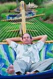 Peli dell'uomo sul Hammock Fotografia Stock Libera da Diritti