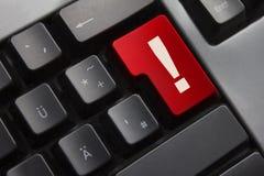 Peligro de la marca de exclamación del botón rojo del teclado Fotografía de archivo libre de regalías