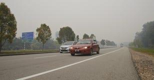 Peligro de la neblina en Malasia Imagenes de archivo