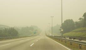 Peligro de la neblina en Malasia Foto de archivo