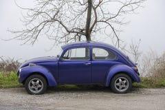 Blue cyan Volkswagen Beetle vintage car. Pelion mountain, Greece - VOLOS- FEBRUARY 26  2017: Blue cyan Volkswagen Beetle vintage car parked in a street front of Royalty Free Stock Image