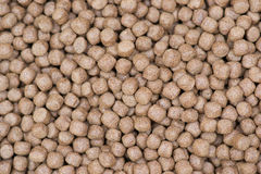 Pellet Fish Feed. Closeup pellet Fish Feed in basket Royalty Free Stock Photos