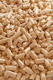Pellets. Of pressed wood, solid backdrop. Vertical shot orientation Royalty Free Stock Image