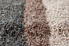 Pellets. Different kind of pellets- pine,beech,sunflower Royalty Free Stock Photo