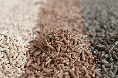 Pellets. Different kind of pellets - pine,beech,sunflower- selective focus on the heap Royalty Free Stock Image
