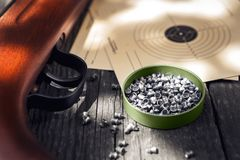 Pellets, air rifle and shooting target Royalty Free Stock Photo