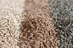 Pellets- biomass. Different kind of pellets- oak, pine,sunflower- selective focus on  the heap Royalty Free Stock Image