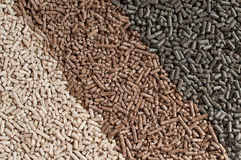 Pellets- biomass. Three  kind of pellets in a row Stock Images
