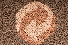 Pellets- Biomass. Three types of pellets forming the sign of recycling Stock Images