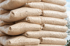 Pellets- Biomass. Heap of stacks of Pine pellets - stock image Stock Photography