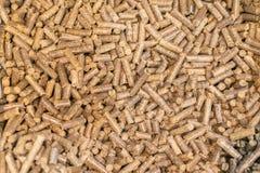 Pellets Biomass- close up studio shot. macro shot of energy efficient wood pellets fills frame. Wood pellets close up .Biofuels. B. Iomass Pellets - cheap energy stock images
