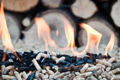Pellets- Biomass. Pellets in flames- stock photo Royalty Free Stock Image