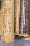 Pellets close up. Wood pellets close up .Biofuels. Biomass Pellets - cheap energy. The cat litter. vertical photo.  stock photo