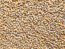 Pellets fish food Stock Photos