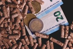 Pellets and the money royalty free stock images