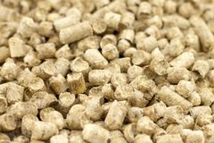 Pellets from sawdust, a background, texture. Soft focus royalty free stock image