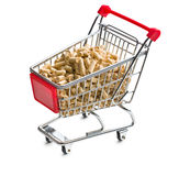 Pellets in shopping cart Royalty Free Stock Photography
