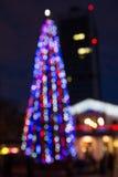 Pelliccia-albero di Bokeh alla notte Fotografie Stock