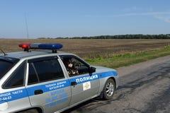 Pelliculage de la fenêtre d'une voiture de police Photo stock