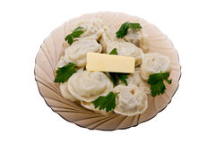 Pelmeni with butter Royalty Free Stock Photo