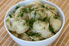 Pelmeni - traditional russian dish. Royalty Free Stock Photos