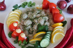 Pelmeni. In white plate pelmeni with lemon tomato cucumber parsley dill Royalty Free Stock Photos