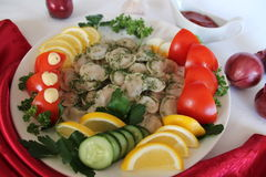 Pelmeni. In white plate pelmeni with lemon tomato cucumber parsley dill Royalty Free Stock Images