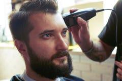 Pelo del corte del peluquero Imagenes de archivo
