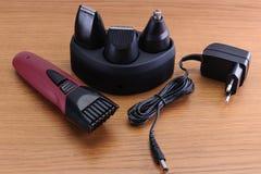 Pelo eléctrico elegante Barber Clippers, accesorios del corte de pelo encendido Foto de archivo