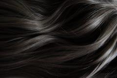 Pelo hermoso Pelo oscuro rizado largo Coloración en color oscuro imágenes de archivo libres de regalías