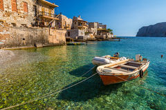 Peloponnese Lakonia. Fishing boats in the clear tropical waters of Gerolimenas, Mani Peninsula, Lakonia, Peloponnese, Greece stock image