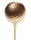 Pelota de golf del oro imágenes de archivo libres de regalías
