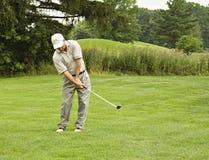 Pelota de golf en el bolsillo izquierdo Foto de archivo