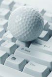 Pelota de golf y teclado imágenes de archivo libres de regalías