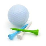 Pelota de golf y tes Fotografía de archivo