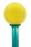 Pelota de tenis y florero Foto de archivo libre de regalías
