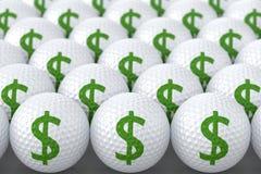 Pelotas de golf con la muestra de dólar Imagen de archivo libre de regalías