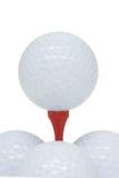 Pelotas de golf y te Foto de archivo