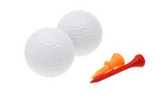 Pelotas de golf y tes foto de archivo