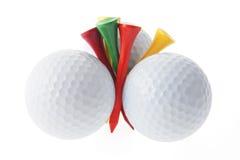 Pelotas de golf y tes Fotos de archivo libres de regalías