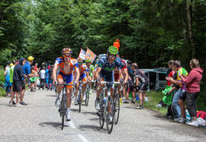 The Peloton. Entremonts,France-July 13th, 2012: Image of cyclists from Rabobank and Movistar Teams in front of the peloton climbing the category mountain pass Stock Images
