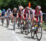 The Peloton. Entremonts,France-July 13th, 2012: Image cyclists from Katusha Team in front of peloton during the climbing the road to mountain pass Granier in the Stock Images