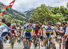 The Peloton on Alpe D'Huez. Alpe-D'Huez,France- July 18, 2013: The peloton climbing the difficult road to Alpe-D'Huez, during the stage 18 of the edition 100 of Stock Image