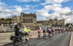 The Peloton and the Amboise Chateau- Paris-Tours 2017 stock photos
