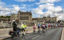 The Peloton and the Amboise Chateau- Paris-Tours 2017 stock photos