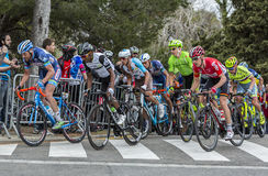 The Peloton in Barcelona - Tour de Catalunya 2016. Barcelona, Spain - March27, 2016: The peloton riding during Volta Ciclista a Catalunya, on the top of Montjuic Royalty Free Stock Photo
