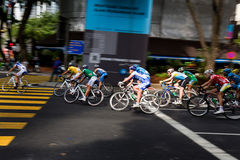 Peloton breaking off. This is the seventh stage of the international bicycle race, le Tour de Langkawi held in city of Kuala Lumpur, Malaysia. The cyclists are Stock Photography